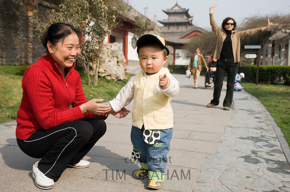 Grandmother and child in park by City Wall, Xian. China has a one child familyl planning policy to limit population.