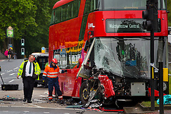 © Licensed to London News Pictures. 04/06/2014. LONDON, UK. A man has died and 13 people have been injured after a N38 bus and a car collided in Lea Bridge Road, at the junction with Essex Wharf in Clapton, east London. Photo credit : Tolga Akmen/LNP