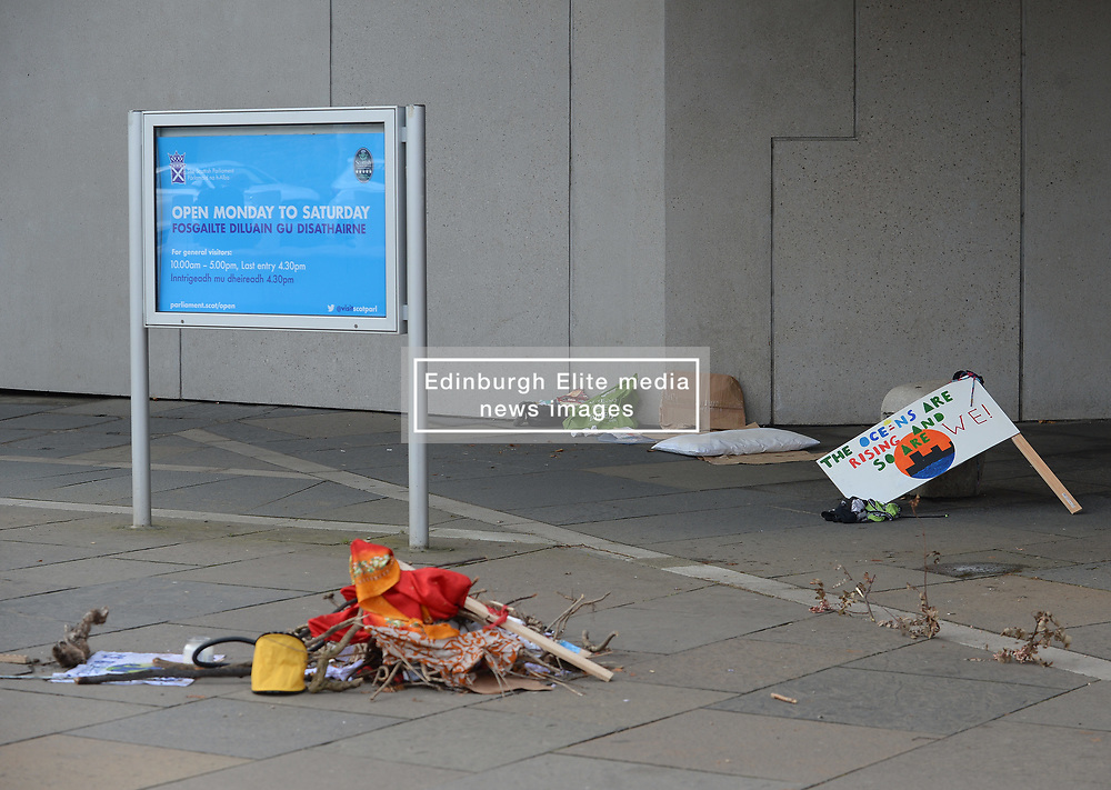Climate activists held a vigil and read the UN IPCC report outside the Scottish Parliament today.<br /> <br /> © Dave Johnston / EEm
