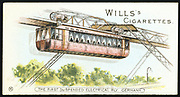 Barmen-Elberfeld (now Wuppertal), Germany, electric overhead monorail, 1901.   This the world's first, and oldest still operating, overhead monorail passenger transport system was designed by the German engineer Eugen Langen (1833-1895), and was opened to the public on 1 March 1901.  From a series of cards, (London, 1901).  Chromolithograph.
