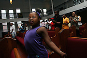 A young girl worshipper is dancing at the hip hop beat during a Mass Service at the Hip Hop Church in Harlem, New York, NY., on Thursday, June 22, 2006. A new growing phenomenon in the United States, and in particular in its most multiethnic city, New York, the Hip Hop Church is the meeting point between Hip Hop and Christianity, a place where ëGodí is worshipped not according to religious dogmatisms and rules, but where the ëHoly Spirití is celebrated by the community through young, unique, passionate Hip Hop lyrics. Its mission is to present the Christian Gospel in a setting that appeals to both, those individuals who are confessed Christians, as well as those who are not regularly attending traditional Services, while helping many youngsters from underprivileged neighbourhoods to feel part of a community, to make them feel loved and to help them not to give up when problems arise. The Hip Hop Church is not only forward-thinking but it also has an important impact where life at times can be difficult and deceiving, and where young people can be easily influenced for the worst purposes. At the Hip Hop Church, members are encouraged to sing, dance and express themselves in any way that the ëSpirit of Godí moves them. Honours to students who have overcome adversity, community leaders, church leaders and some of the unsung pioneers of Hip Hop are common at this Church. Here, Hip Hop is the culture, while Jesus is the centre. Services are being mainly in Harlem, where many African Americans live; although the Hip Hop Church is not exclusive and people from any ethnic group are happily accepted and involved with as much enthusiasm. Rev. Ferguson, one of its pioneer founders, has developed ëHip-Hop Homileticsí, a preaching and worship technique designed to reach the children in their language and highlight their sensibilities, while bringing forth Christianity. This ëKeep It Realí evangelism style is the centrepiece of Rev. Fergusonís ministry, one that speaks the plain