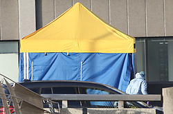 © Licensed to London News Pictures. 30/11/2019. London, UK. A police forensics officer is seen at an evidence tent on London Bridge the day after a terrorist attack. Two people were killed and three injured after the attacker, named by police as 28-year-old Usman Khan stabbed a man and a woman to death on London Bridge. Photo credit: Peter Macdiarmid/LNP