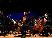 Orange County Youth Symphonic Orchestra cellists Brian Liu and Matthew Teng listen during a dress rehearsal for a joint performance with Beckman High School String Orchestra at Chapman University's Julianne Argyros Orchestra Hall on Sunday, May 14, 2017 in Orange, Calif. (Photo by Josh Barber, Orange County Register Contributing Photographer)