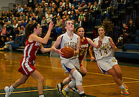 Gilford's Stevie Orton looks towards the basket under pressure from Laconia's Kailey Nute and Cheyanne Zappala during Friday night basketball at Gilford High School.  (Karen Bobotas/for the Laconia Daily Sun)