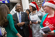 Retired Neurosurgeon and Republican presidential candidate Dr. Ben Carson greets staff and volunteers after listening to Christmas carols during a visit to the MUSC Children's Hospital December 22, 2015 in Charleston, South Carolina. Carson stopped by to listen to Christmas carols and greet the young patients.