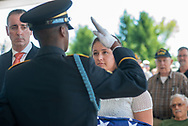 Justine Newman (right) of the Chester County Coroners office is handed an American flag used during burial services with full military honors, held for 12 veterans left unattended by family or friends Thursday, August 29, 2019 at Washington Crossing National Cemetery in Washington Crossing, Pennsylvania. Standing to the left is Rep. Brian Fitzpatrick. Once a month, burials are held for veterans who have no family and their remains have never been claimed. Some vets remains have waited 12 years for burial. Justine was instrumental in the burial of 9 veterans from Chester County.  (Photo by William Thomas Cain / CAIN IMAGES)