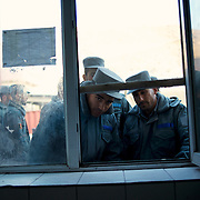 Afghan National Police (ANP) cadets wait for the distribution of hot milk outside the kitchen of the Afghan Nacional Police Academy in Kabul.
