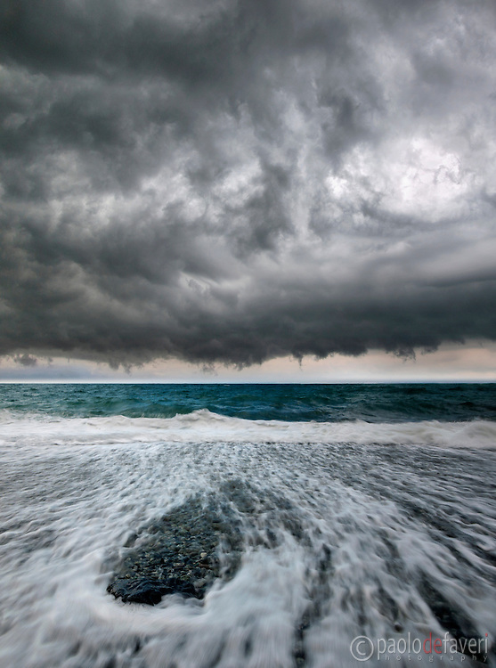 A huge storm approaching the beach of Monterosso al Mare, one of the five medieval fishermen villages alltogether known as Cinque Terre, in the Italian Riviera, Liguria, Italy.