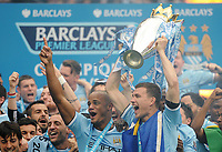 Football - 2013 / 2014 Premier League - Manchester City vs. West Ham United<br /> Manchester City's Edin Dzeko and Vincent Kompany lifts the Barclays Premier League trophy following their teams win at the Etihad Stadium, Manchester