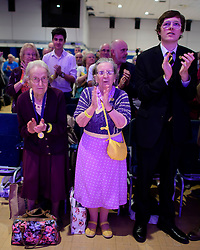 ©  London News Pictures. 17/09/2016. Bournemouth, UK. UKIP supporters hold a minutes applause in the memory of UKIP campaigners who have died, at Day 2 of the 2016 UKIP Autumn Conference, held at the Bournemouth International Centre in Bournemouth, Dorset. On Friday, the party elected Diane James as their new leader, following Nigel Farage resignation after the UK voted to leave the EU in a referendum..  Photo credit: Ben Cawthra/LNP