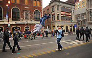 PHILADELPHIA - JANUARY 1: D.J. McCorkle (L) flips with some help from Danny McCorkle (R) both of Drexel Hill, Pennsylvania during a lull in the 2011 Mummers Parade in Philadelphia, Pennsylvania. Thousands of people enjoyed the warmer weather and watched the parade, which has been around for over 100 years. (Photo by William Thomas Cain/Getty Images)