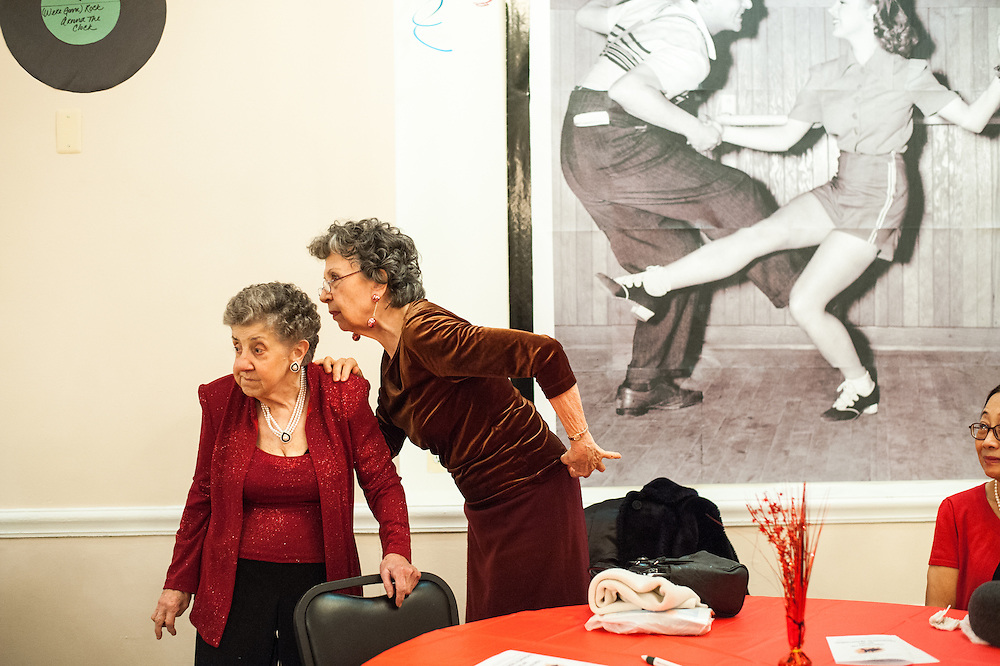 Margaret Cinoli and Mary Lou Quinn talk while other seniors dance and the music of the Freenotes plays at the Oak Park Arms' Valentine's Day Dance on Friday, February 13, 2015.