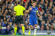 Chelsea defender César Azpilicueta (28) high fives the Referee Cuneyt Cakir after a collision during the Champions League match between Chelsea and Valencia CF at Stamford Bridge, London, England on 17 September 2019.