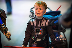 "© Licensed to London News Pictures . 06/12/2015 . Manchester , UK . Darth Vadar ( Keiran Seaman , five ) bursts in to tears when his lightsaber breaks , during a duel with his older brother . Fans attend Star Wars exhibition "" For the Love of the Force "" at Bowlers Exhibition Centre in Manchester . Photo credit : Joel Goodman/LNP"