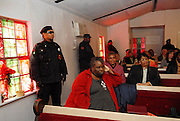 Members of the New Black Panther Party surround the interior of the Anitoch Baptist Church during Rev Sharptons remarks Sunday Jan. 18,2008. Sharpton came to Jena the day before Martin Luther King holiday because the Nationalist Movement lead by Richard Barrett is to march on Jena Monday during MLK holiday. The Nationalist movement is coming to Jena in response to the Jena 6 rally last year. The town of Jena Louisiana rescheduled their Martin Luther King Holiday festivities from Monday to Sunday because the Nationalist Movement planned a march in Jena on MLK day. Sharpton came to Jena the day before Martin Luther King holiday because the Nationalist Movement lead by Richard Barrett is to march on Jena Monday during MLK holiday. The Nationalist movement is coming to Jena in response to the Jena 6 rally last year. Sharpton was in Jena to protest the Jim Crow Justice still prevalent in the south. Sharpton discussed his feeling about MLK's legacy and how it should be celebrated and that their are still, today in the South many things to fight for, Equal Justice would be at the top of his list. Sharpton said you can not heal the community until justice is dealt with fairly, no white justice or black  justice -Equal Justice for all is what will heal the town of Jena.(Photo/© Suzi Altman)