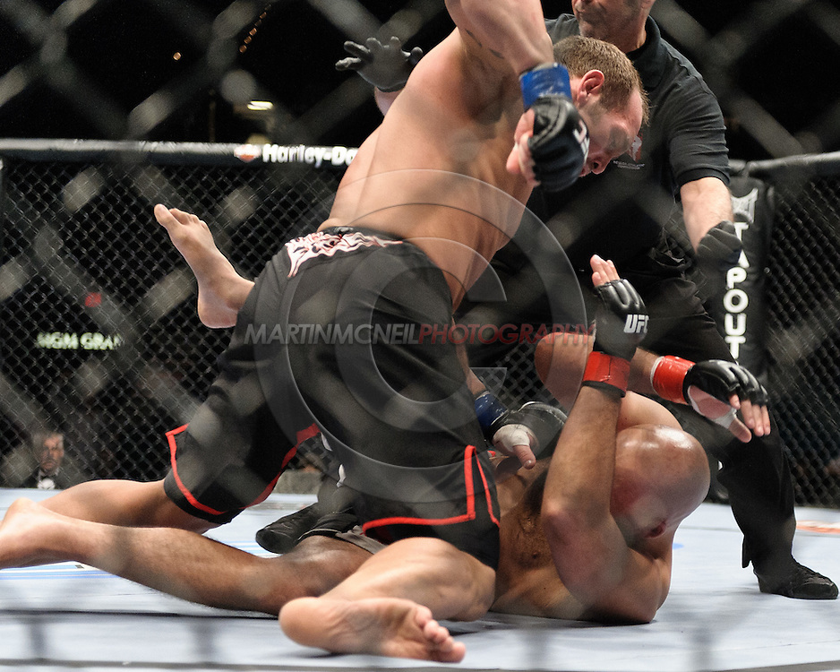 "LAS VEGAS, NEVADA, MAY 24, 2008: Shand Carwin (top) rains down blows on Christian Wellisch during ""UFC 84: Ill Will"" inside the MGM Grand Garden Arena in Las Vegas"