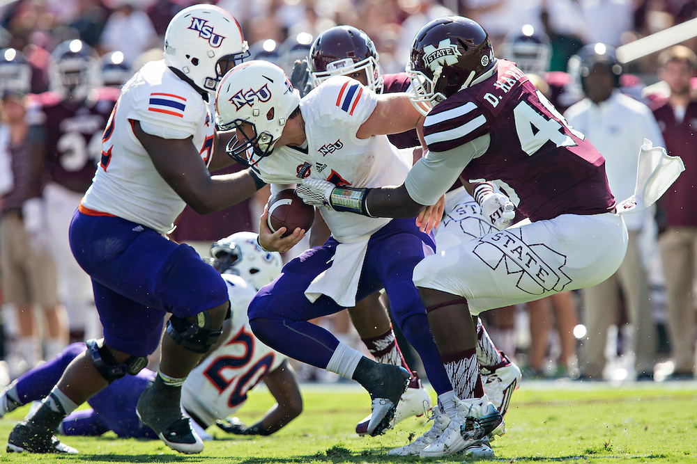 STARKVILLE, MS - SEPTEMBER 19:  Dezmond Harris #46 of the Mississippi State Bulldogs sacks J.D. Almond #5 of the Northwestern State Demons at Davis Wade Stadium on September 19, 2015 in Starkville, Mississippi.  The Bulldogs defeated the Demons 62-13.  (Photo by Wesley Hitt/Getty Images) *** Local Caption *** Dezmond Harris; J.D. Almond