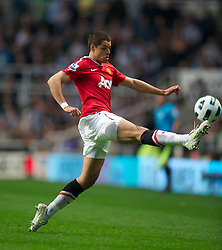 NEWCASTLE, ENGLAND - Tuesday, April 19, 2011: Manchester United's Javier Hernandez in action against Newcastle United during the Premiership match at St James' Park. (Photo by David Rawcliffe/Propaganda)