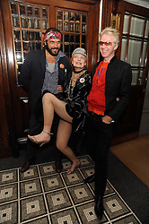 Left to right, MR ANDREAS KRONTHALER, DAME VIVIENNE WESTWOOD and PHILIP TREACY at Vogue's Celebation of Fashion dinner held at The Albermarle, Brown's Hotel, Albermarle Street, London on 18th September 2008.