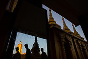 Three tourists are reflected in a mirror during a visit to the Laykyun Setkyar Buddha, the second largest standing Buddha statue in the world, at Maha Bodhi Ta Htaung monastery in the Sagaing Region, Myanmar. At 31 stories tall, the sculpture dominates the skyline. Inside, each of its 31 floors feature murals depicting the 31 planes of existence associated with Buddhist theology.