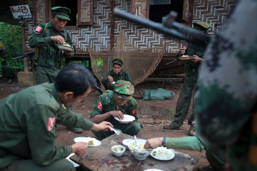 KIA's members take the breakfast in Rubber Hill Post a former Burmese post recover one month ago, Laja Yang village outskirts of Laiza, Kachin State, Myanmar on August 8, 2012. The KIA formed in 1961 in response to a military coup in Burma led by General Ne Win, who attempted to consolidate Burmese control over regions on the periphery of the state which were home to various ethnic groups. From 1961 until 1994, the KIA fought a grueling and inconclusive war against the Burmese junta. In 2011, general Sumlut Gun Maw confirmed renewed fighting in the state of Kachin for independence. One of the new reasons for the ending of the ceasefire is the creation of the Myitsone Dam which requires the submergence of dozens of villages in Kachin state.