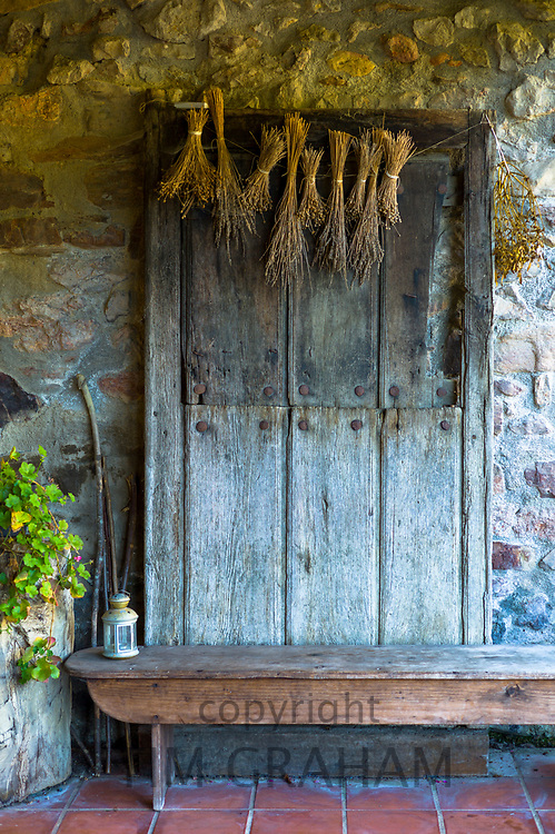 Old Basque wooden door with corn drying at Casa Rural Ametzola hotel in the Biskaia Basque region of Northern Spain