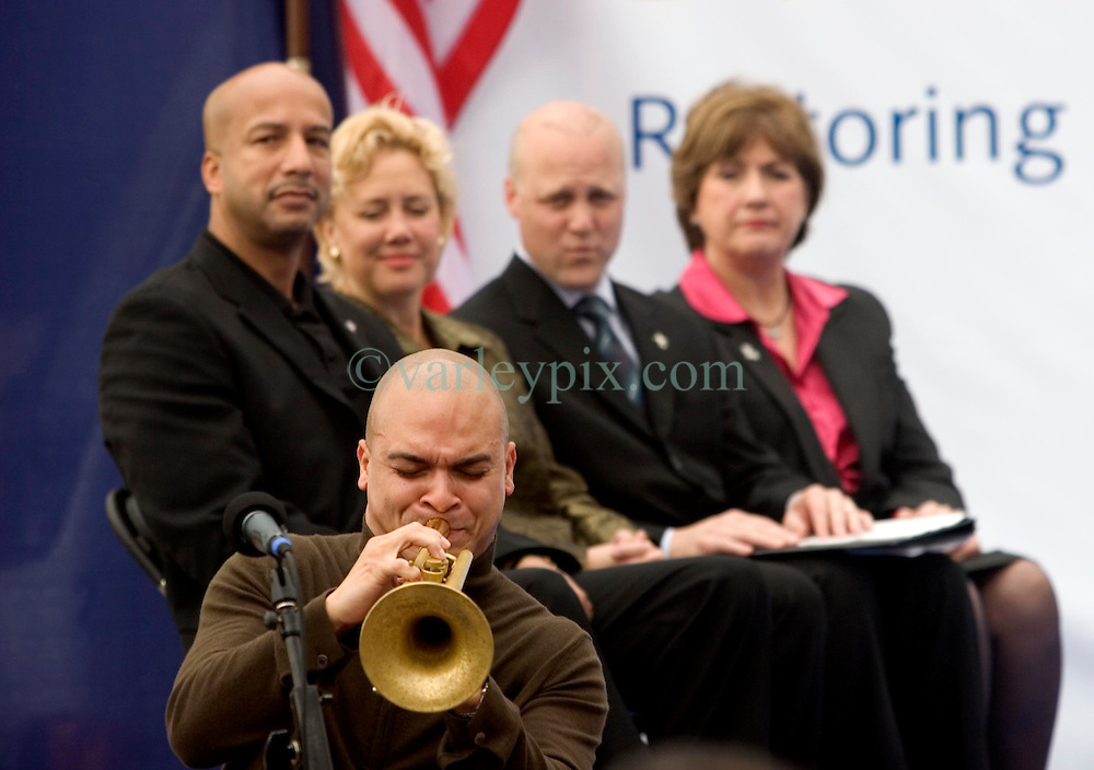 1st January, 2006. New Year's Day in New Orleans, Louisiana. Louisiana Rebirth interfaith service at the Superdome rings out the old disasterous 2005 and rings in what politicians and locals hope will be a successful 2006. Legendary Jazz trumpeter Irvin Mayfield plays a touching tribute to his late father as politicians (from left) Mayor Ray Nagin, US Senator Mary Landrieu, Lieutenant Govenor Micth Landrieu and Govenor Kathleen Blanco look on.<br />  Photo; Charlie Varley/varleypix.com