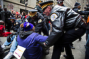 Chicago Police arrest a sit down protester during a rally on March 27, 2013 protesting the closing of 54 Chicago public schools. Hundreds of teachers, school employees, parents, students and community members came out to the protest the schools closings which are expected to effect more than 30,000 students in the Chicago Public School system.
