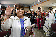 DUBLIN, PA - OCTOBER 24: Raquel Puente (L), of Equador takes the Oath of Citizenship during a Naturalization ceremony October 24, 2014 at the Pearl S. Bucks House in Dublin, Pennsylvania. 48 applicants from 28 countries were naturalized during the ceremony, and became U.S. citizens. (Photo by William Thomas Cain/Cain Images)
