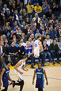 Golden State Warriors guard Stephen Curry (30) celebrates a three pointer with fans against the Charlotte Hornets at Oracle Arena in Oakland, Calif., on February 1, 2017. (Stan Olszewski/Special to S.F. Examiner)