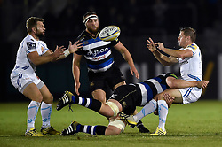 Gareth Steenson of Exeter Chiefs offloads the ball to team-mate Dave Lewis after being tackled - Mandatory byline: Patrick Khachfe/JMP - 07966 386802 - 10/10/2015 - RUGBY UNION - The Recreation Ground - Bath, England - Bath Rugby v Exeter Chiefs - West Country Challenge Cup.