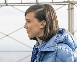 November 20, 2018 - New York, New York, United States - Millie Bobby Brown wearing dress by Altuzarra and jacket by Moncler new UNICEF Goodwill Ambassador lights Empire State Building in blue to honor World Children's  Day at ESB Observatory (Credit Image: © Lev Radin/Pacific Press via ZUMA Wire)