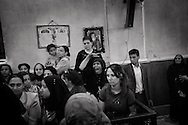 Egypt, Cairo:  A woman reacts in St. Mark Coptic Church as the Egyptian exorcist father Makari Yunan performs his ritual. ph.Christian Minelli..