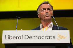 Bournemouth, UK. 15 September, 2019. Andrew George, former Liberal Democrat MP for St Ives, speaks on the Stop Brexit motion during the Liberal Democrat Autumn Conference. Following a vote won by an overwhelming majority, the Liberal Democrats pledged to cancel Brexit if they win power at the next general election. This marks a shift in policy from their previous backing for a People's Vote. Credit: Mark Kerrison/Alamy Live News