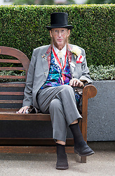 © Licensed to London News Pictures. 19/06/2018. London, UK.  Former race commentator John McCririck attends day one of Royal Ascot at Ascot racecourse in Berkshire, on June 19, 2018. The 5 day showcase event, which is one of the highlights of the racing calendar, has been held at the famous Berkshire course since 1711 and tradition is a hallmark of the meeting. Top hats and tails remain compulsory in parts of the course. Photo credit: Ben Cawthra/LNP