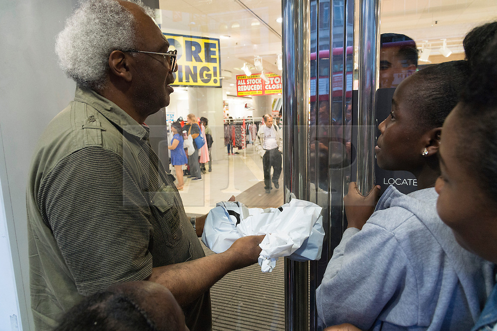 © Licensed to London News Pictures. 13/08/2016. Customer with grey hair and spectacles pleads with security staff to let him into the store for a refund as British Homes Stores Oxford Street Flagship store as it closes on its last day of trading. London, UK. Photo credit: Ray Tang/LNP