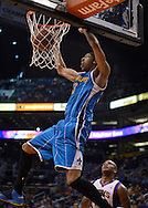 Apr 7, 2013; Phoenix, AZ, USA; New Orleans Hornets forward Anthony Davis (23) dunks the ball against the Phoenix Suns in the second half at US Airways Center. The Hornets defeated the Suns 95-92. Mandatory Credit: Jennifer Stewart-USA TODAY Sports