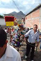 "Mexico, Oaxaca, Teotitlan del Valle, April 18, 2011. On a moody Monday in southern Mexico, the Zapotec townspeople of Oaxaca's Teotitlan del Valle reenact all fourteen Stations of the Cross through this mountain community's winding cobblestone streets. From the first station, where Jesus is condemned to die, to the last, where he is laid in his tomb, somber processions accompanied by flowers, singers and a brass band stop at each refuge, adorned with ""tapetes"" created by master carpet weavers and blessed with food and drink for all. Multimedia and more at www.mexicoculturalcalendar.com"