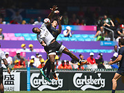 Two players compete for a high ball at a restart in the game Fiji vs Argentina during the Cathay Pacific/HSBC Hong Kong Sevens festival at the Hong Kong Stadium, So Kon Po, Hong Kong. on 8/04/2018. Picture by Ian  Muir.
