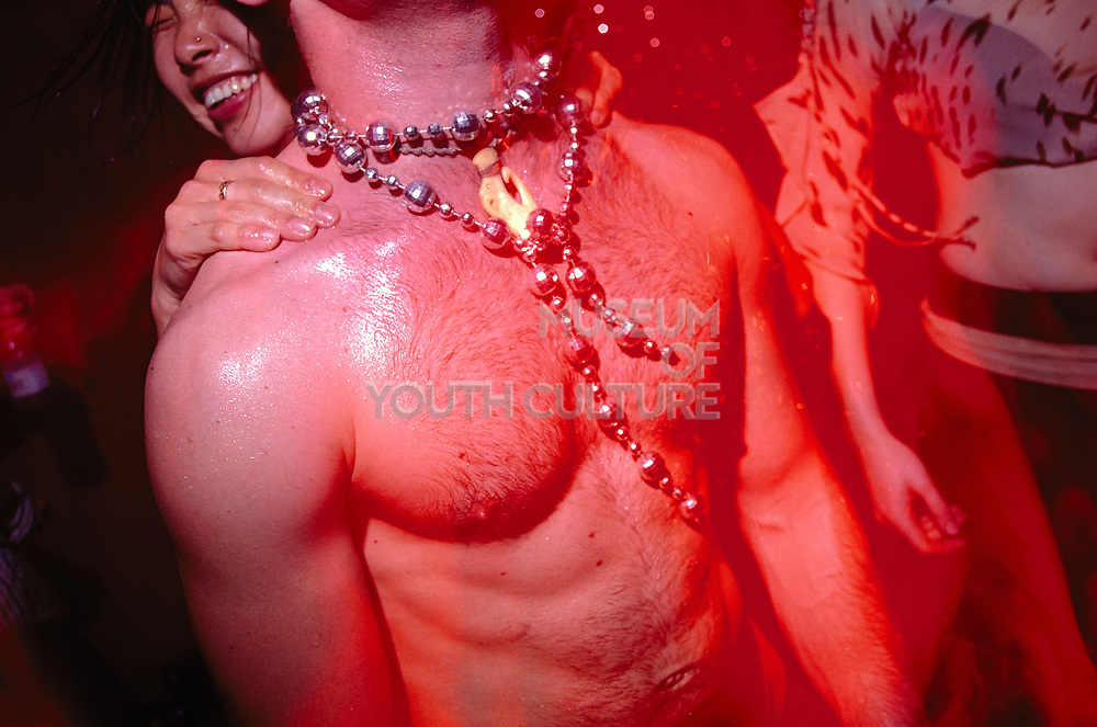 Bare chested man with necklace at Club 144 London May 2002