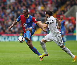 Crystal Palace's Cameron Jerome vies for possession with Swansea City's Chico - Photo mandatory by-line: Robin White/JMP - Tel: Mobile: 07966 386802 22/09/2013 - SPORT - FOOTBALL - Selhurst Park - London - Crystal Palace V Swansea City - Barclays Premier League