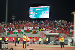 NOVI SAD, SERBIA - Tuesday, September 11, 2012: Wales supporters look dejected as the scoreboard records their 6-1 defeat to Serbia during the 2014 FIFA World Cup Brazil Qualifying Group A match at the Karadorde Stadium. (Pic by David Rawcliffe/Propaganda)