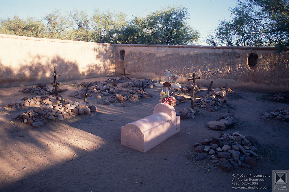 Graveyard at Tumacacori Mission, Child's grave in foreground, Tumacacori, Arizona..Rights & Usage:.No rights granted. Subject photograph(s) are copyrighted by Edward McCain/McCain Photography. All rights are reserved except those specifically granted in writing prior to any use...McCain Photography.211 S 4th Avenue.Tucson, AZ 85701-2103.(520) 623-1998.mobile: (520) 990-0999.fax: (520) 623-1190.http://www.mccainphoto.com.edward@mccainphoto.com