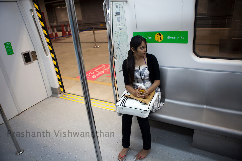 "Ashyan Thakrel, 21, travels in the ladies section of a metro train from the Central Secratariat station using the ""Yellow Line"" route of the Delhi Metro network in New Delhi, India, on Friday, October 22, 2010. Photographer: Prashanth Vishwanathan/HELSINGIN SANOMAT"