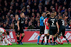 Hakim Ziyech #22 of Ajax and Ramon Leeuwin #27 of AZ Alkmaar, Myron Boadu #9 of AZ Alkmaar and Referee Serder Gozubuyuk  during the Dutch Eredivisie match round 25 between Ajax Amsterdam and AZ Alkmaar at the Johan Cruijff Arena on March 01, 2020 in Amsterdam, Netherlands