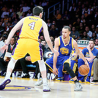 11 April 2014: Los Angeles Lakers forward Ryan Kelly (4) defends on Golden State Warriors guard Stephen Curry (30) during the Golden State Warriors 112-95 victory over the Los Angeles Lakers at the Staples Center, Los Angeles, California, USA.