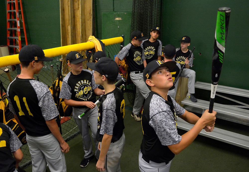 gbs073117l/SPORTS -- Eastdale Little Leaguer Nikko Barela, 12, holds a bat before an indoor practice because of rain at the Back 2Back batting cages on Monday, July 31, 2017. (Greg Sorber/Albuquerque Journal)