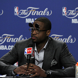 Jun 19, 2012; Miami, FL, USA; Miami Heat shooting guard Dwyane Wade talks to the media during the post game press conference after game four in the 2012 NBA Finals against the Oklahoma City Thunder at the American Airlines Arena. Miami won 104-98. Mandatory Credit: Derick E. Hingle-US PRESSWIRE