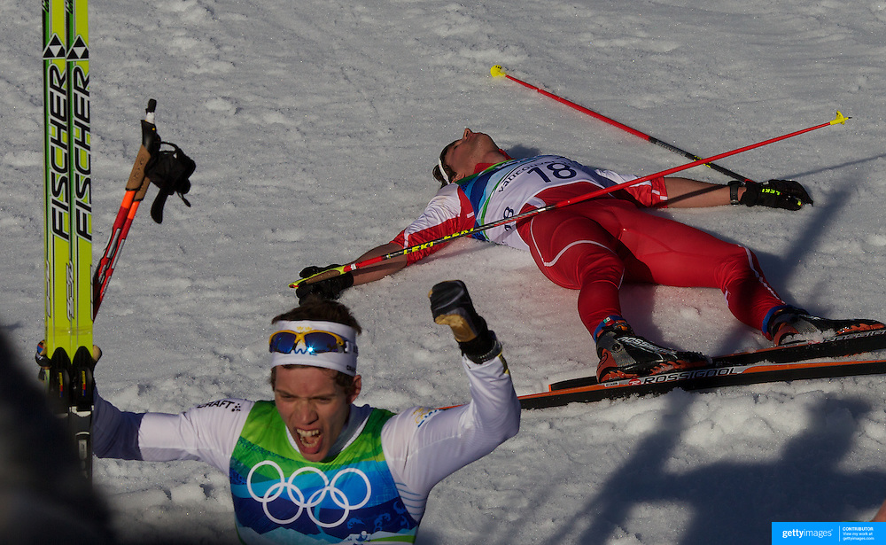 Winter Olympics, Vancouver, 2010.Marcus Hellner, Sweden, wins the Men's 30km Pursuit Cross Country event as Curdin Perl, Switzerland, lays collapsed on the ground at Whistler Olympic Park, Whistler, during the Vancouver Winter Olympics. 20th February 2010. Photo Tim Clayton
