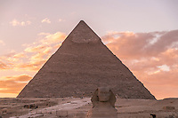 Chephren Pyramid and Sphinx seen at sunset in Giza, Egypt.